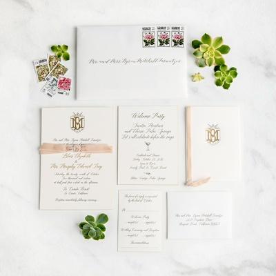 White wedding invitation with calligraphy gold monogram pretty stamps calligraphy pink velvet ribbon