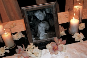 Black and white engagement photo in frame at reception