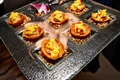 Chicago wedding cocktail hour with hors d'oeuvres and purple orchid detail on tray