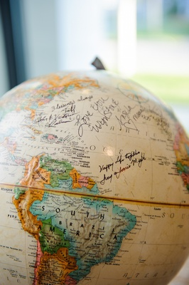 Ivory and colorful globe map with notes from guests