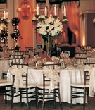 Round tables and chairs with bows on back