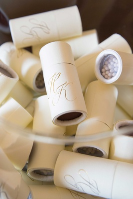 Wedding favors in glass bowl matches in round packaging with wedding monogram