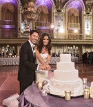 Bride in Vera Wang dress and groom cut into cake at Hilton Chicago wedding reception