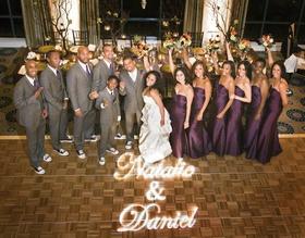 African American wedding party on dance floor