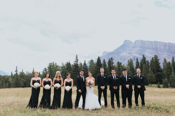 groom in Ermenegildo Zegna, bride in Watters, bridesmaids in black sequin gowns, Banff National Park