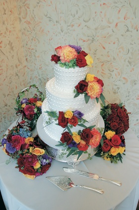 Three layer white cake with vibrant fresh flowers
