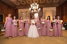 bride in essence of australia wedding dress, bridesmaids in dusty rose monique lhuillier dresses