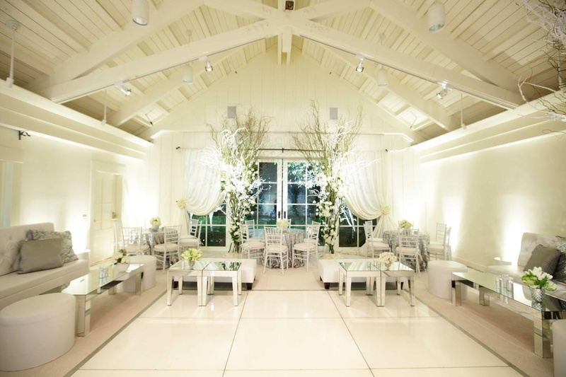 White drapery and furniture and mirrored tables
