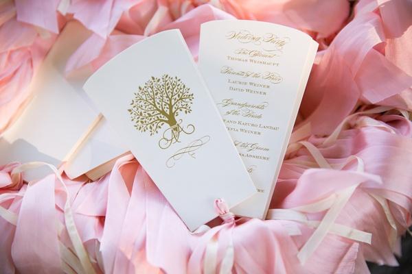 cream wedding ceremony program with gold print and tree design