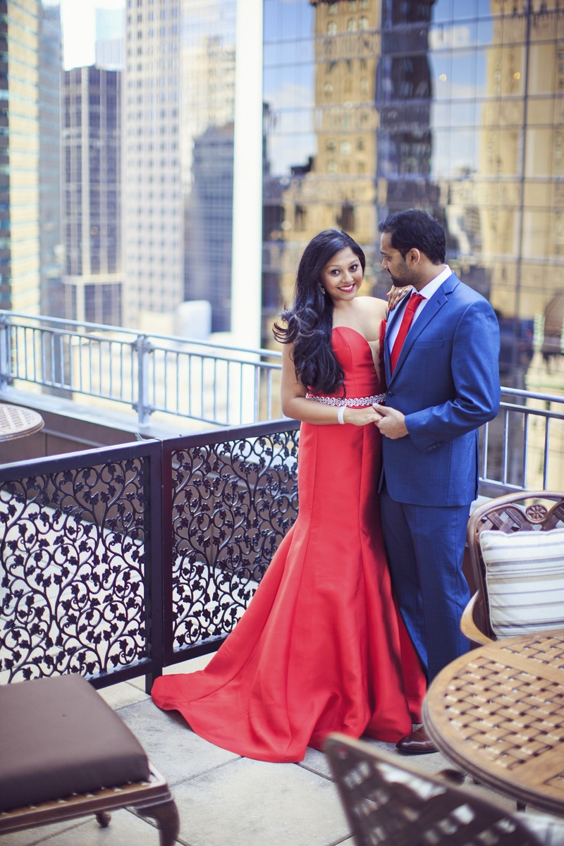 7c8740e2e South Indian couple, bride in red wedding gown, groom in blue suit with red