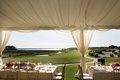 Tented reception with a view of golf course and water at Colleton River Plantation Club