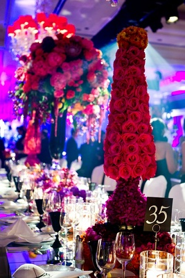 Hot pink roses in shape of cone on reception table