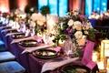 wedding reception table purple linen low centerpiece pink purple white greenery details barn
