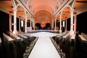 Vibiana wedding ceremony white stage floating candles in the round seating altar white columns