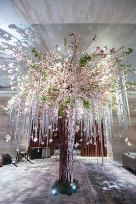 cherry tree escort card display ribbons modern garden new york wedding indoors uplighting jewish