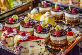 Silver platter topped with berry desserts and treats