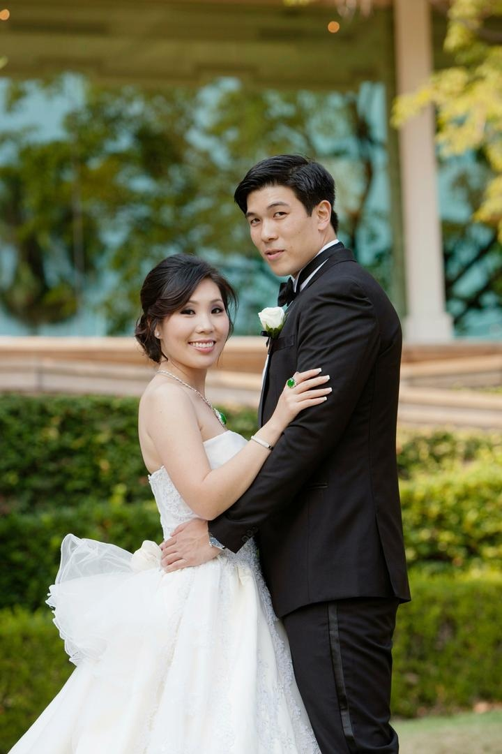 Chinese-American couple in wedding dress and tuxedo