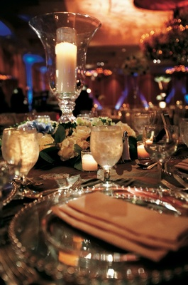 Ballroom reception with candlelight and beaded charger plate