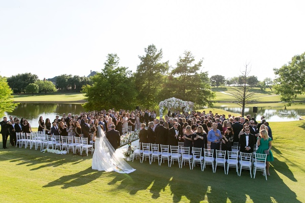 Bride with veil walking with father of bride toward aisle dallas wedding golf course white chairs