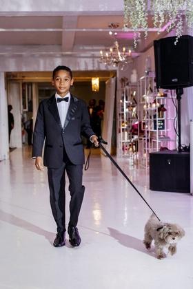 Wedding reception dog friendly grey dog with black leash walked by young man tuxedo