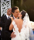 Mario Lopez and Courtney Mazza kissing at wedding