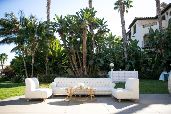 Outdoor cocktail hour tufted sofa roll arm settees gold coffee table tufted panel wedding bar