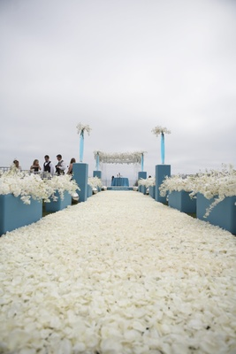 aisle covered with carpet of white flower petals