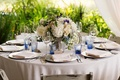 Rustic wedding centerpiece with vintage mirror and simple centerpiece