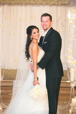 MLB player baseman Atlanta Braves Chris Johnson and bride Tia Garavuso on wedding day at ceremony