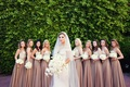 Bride in off-the-shoulder gown with bridesmaids
