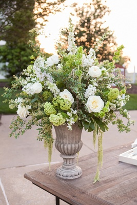 Antique-style urn filled with natural flowers