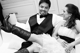 Black and white photo of bride wearing cowboy boots