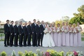 Bride in strapless Anne Barge dress, groom in tuxedo, bridesmaids in long lavender dresses