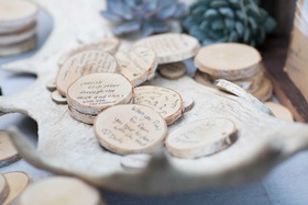 well wishes for the bride and groom on small tree branch stumps saucers coasters rustic