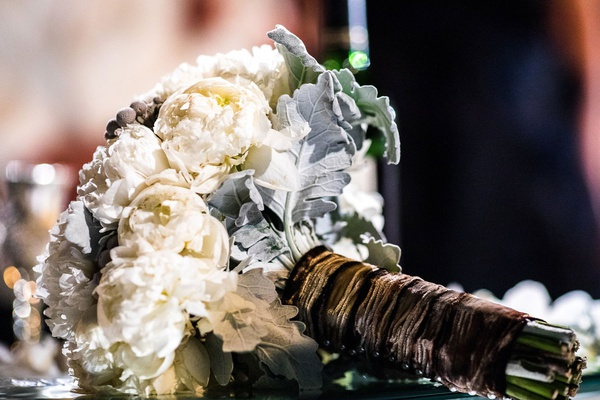 wedding bouquet with dusty miller accents for destination wedding on table