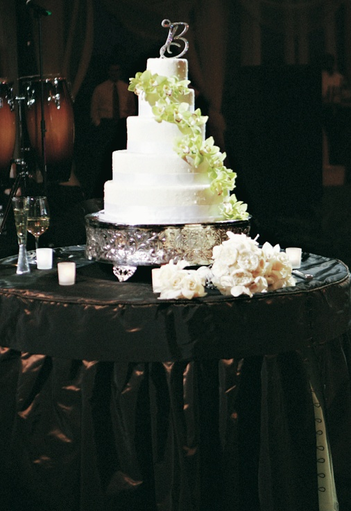 Five layer wedding confection with green flowers