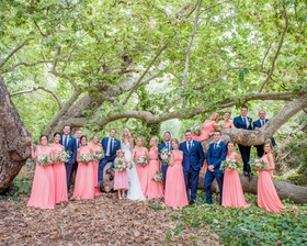 bridesmaids in coral bridesmaid dresses groomsmen in bright blue suits and ties wedding california