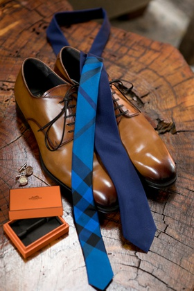 light brown groom shoes, navy tie with bright blue plaid detail