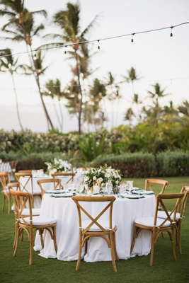 maui destination wedding, outdoor reception,vineyard chairs, white linens, bistro lights
