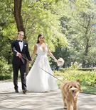 bride in hayley paige a-line gown with sequin details, groom in tuxedo, bride and groom walking dog