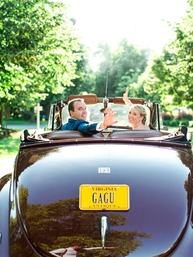 Bride and groom wave goodbye in 1940 Ford Super Deluxe sedan car virginia license plate convertible