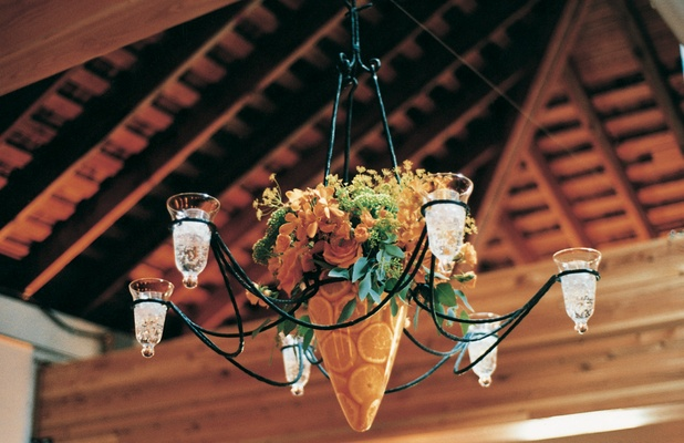 Chandelier with orange slices in base hanging from ceiling