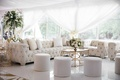 wedding reception chesterfield tufted sofa and armchair ottoman gold table white decorations
