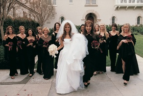 White Vera Wang wedding dress and black bridesmaid dresses
