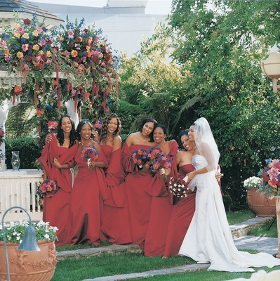 Bridesmaids in red gowns and shawls