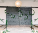 hoop wreaths with greenery and bannister with greenery as wedding ceremony backdrop
