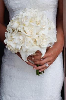 Bride holding gardenias and magnolia