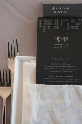 Art Deco-inspired menus in white linen napkin