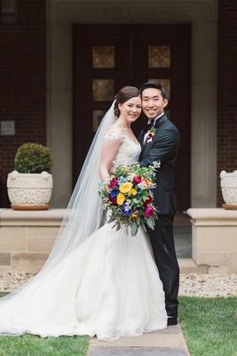 couples portrait colorful bouquet wedding dayton ohio interracial long veil tux dress