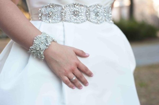 Bride with white wedding dress, crystal bracelet, and belt